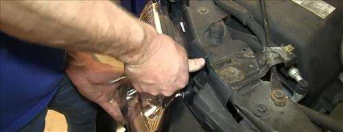 How To Install Replace Headlight and Change Bulb 2002-09 GMC Envoy step 15