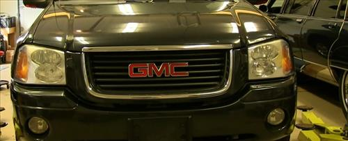 How To Install Replace Headlight and Change Bulb 2002-09 GMC Envoy step 17