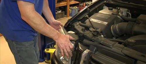 How To Install Replace Headlight and Change Bulb 2002-09 GMC Envoy step 5