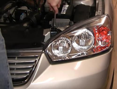 How To Install Replace Headlight and bulb Chevy Malibu 04-08 step 12