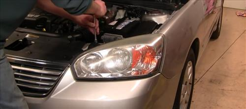 How To Install Replace Headlight and bulb Chevy Malibu 04-08 step 3