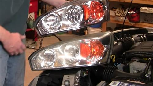 How To Install Replace Headlight and bulb Chevy Malibu 04-08 step 9