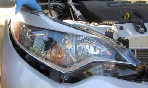 How to Replace Headlight Bulb 2015-2018 Toyota Corolla Low Beam Step 9